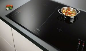 How does it work and what are the advantages of induction cookers?
